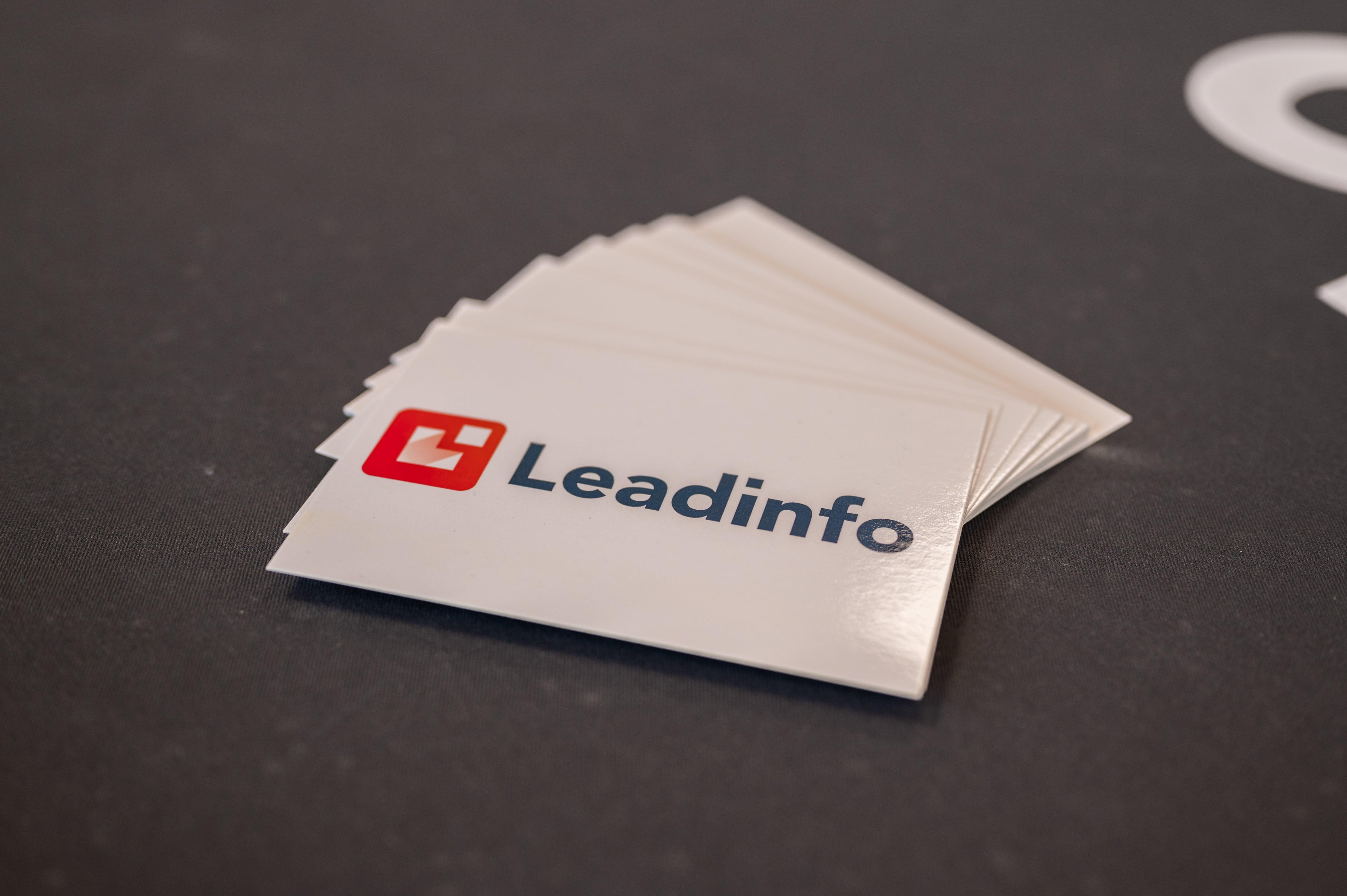 Leadinfo business cards spread out in a fan shape